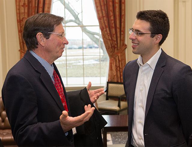 Ezra Klein speaking with President Hodge at the Janus Forum reception