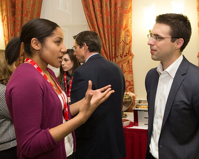 Ezra Klein speaking to a student at the Janus Forum reception