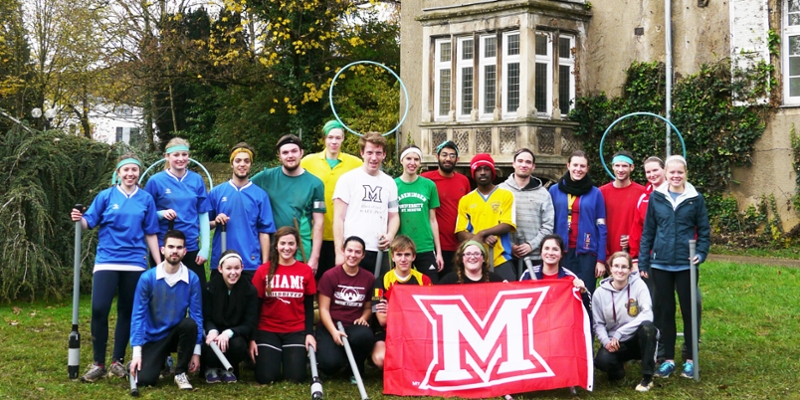Quidditch players pose outside the Chateau