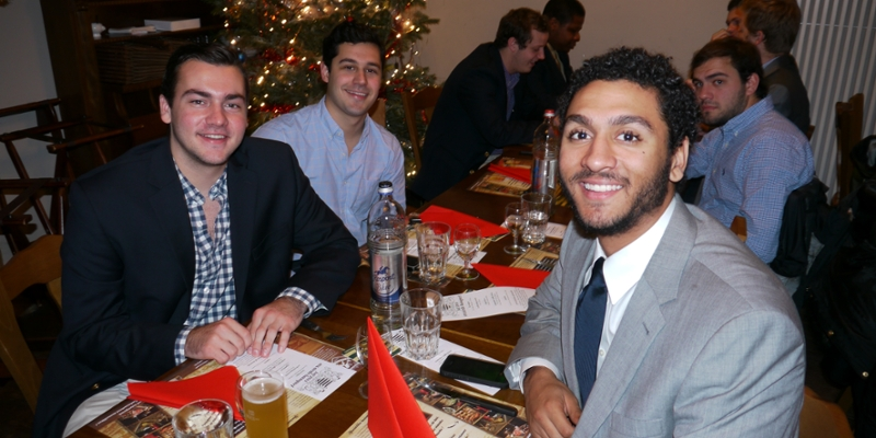 A group of young men enjoy a holiday dinner
