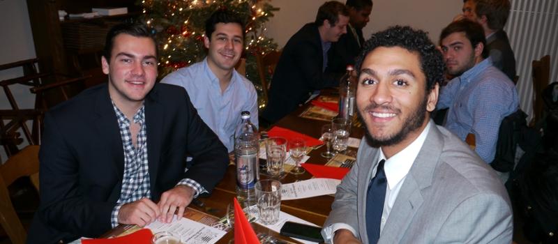 Men enjoy a holiday meal together
