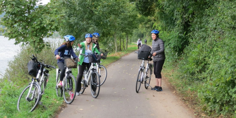 A group of students bicycle through the countryside