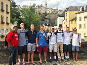 Several students pose near a canal in Luxembourg City