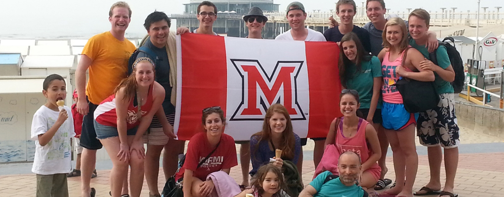 Blankenberge group poses with Miami M flag
