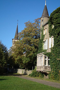 Exterior of the chateau, covered in ivy