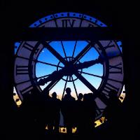 Backlit clock at night in Paris