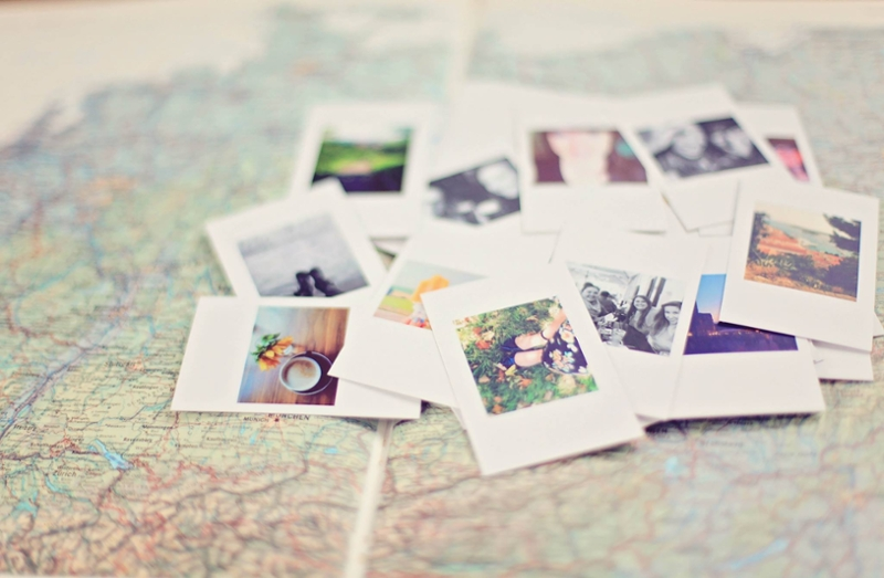Photos of travel laid on top of a map