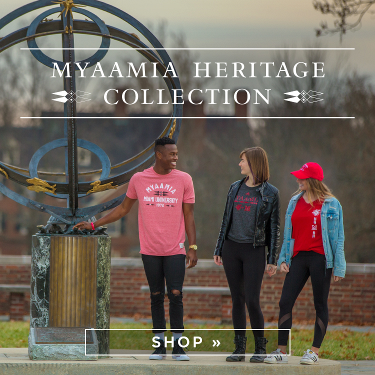 Myaamia Heritage Collection. Three students wearing heritage collection apparel stand by the sundial on central quad. Shop