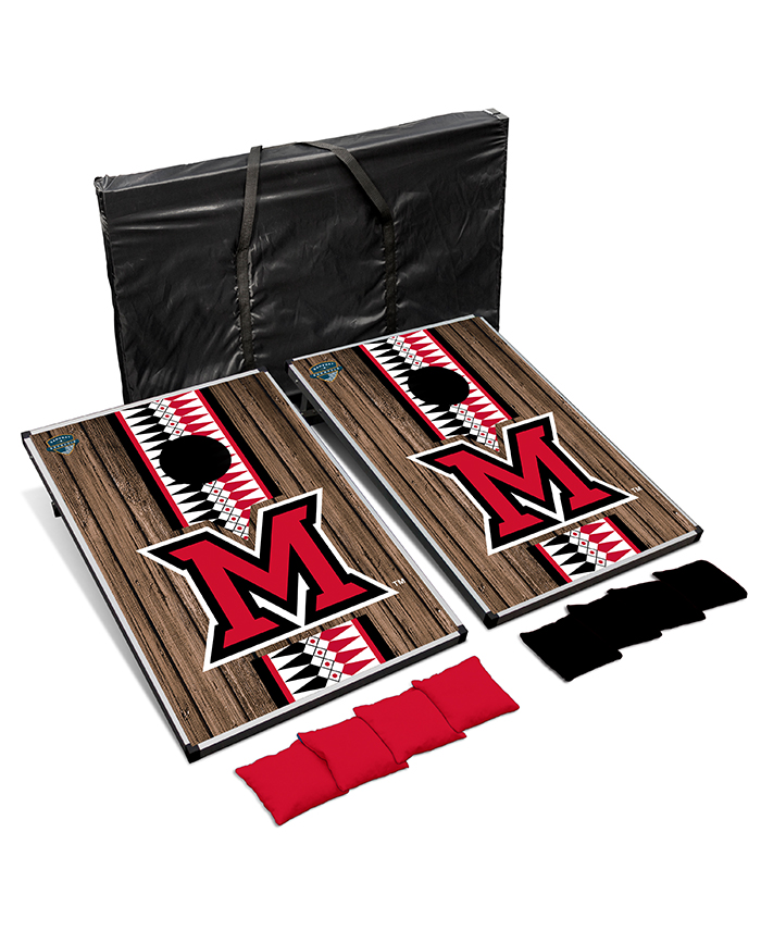 A cornhole set with a large Miami beveled M and a vertical stripe filled with the ribbonwork pattern.