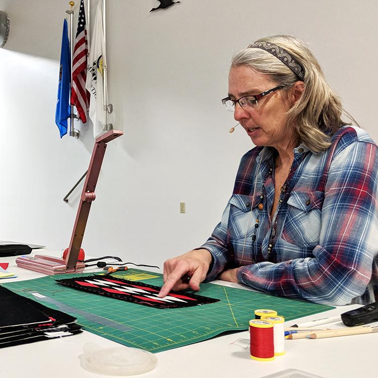 Karen Baldwin demonstrates ribbonwork