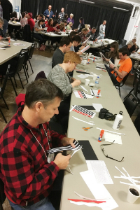 Michael Mattingly and others creating ribbonwork