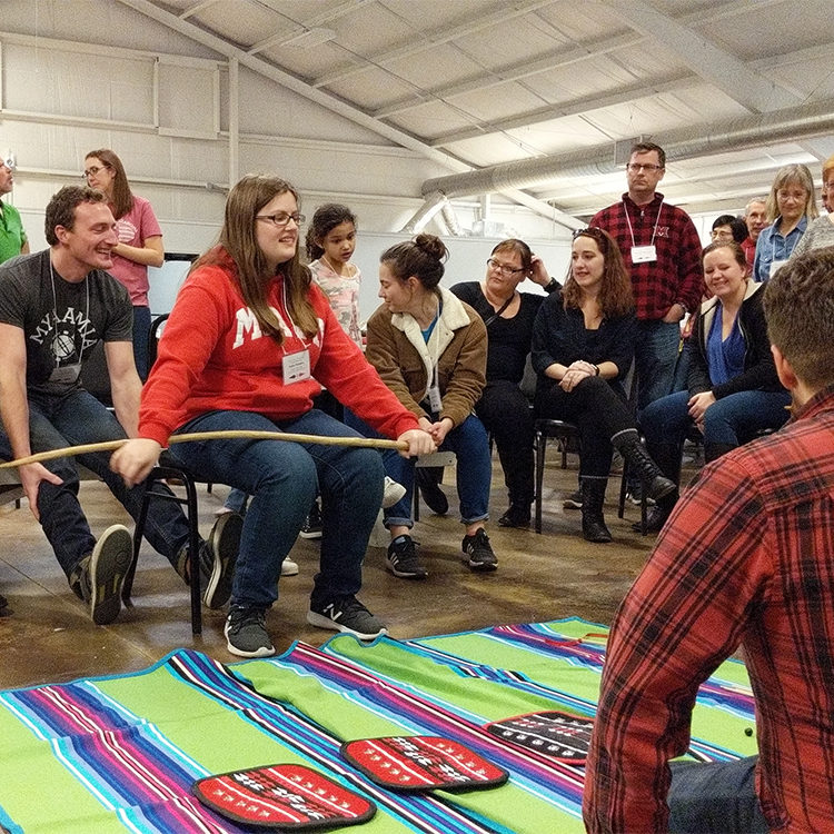 Students playing the moccasin game