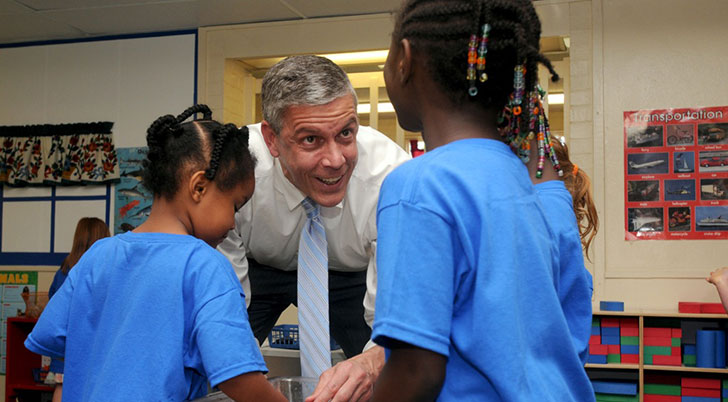 Secretary of Education Arne Duncan visits with children in the YMCA Children's Center on Miami Middletown's campus.