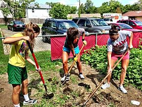Rachel Goddard, Nicole Anderson and Jillian Spurlock, incoming first-year students and members of Miami's women's basketkball team, tended the garden at Oxford's Family Resource Center.