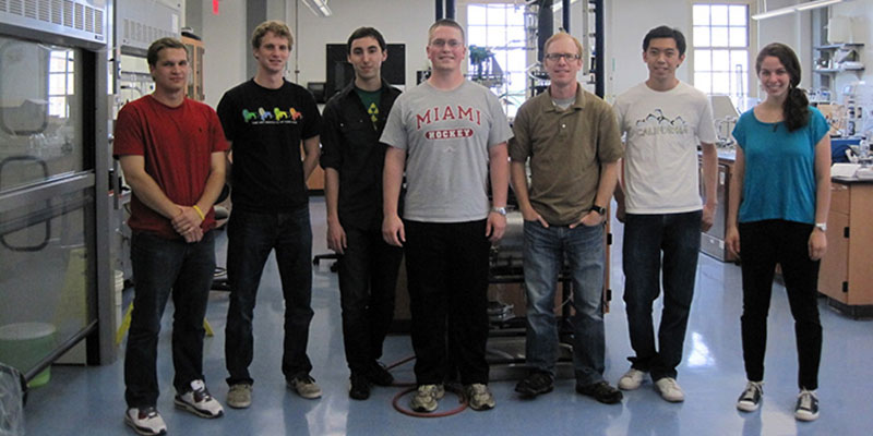 Jason Berberich (third from right) surrounded by his team of student researchers (left to right) Jordan Boivin, Dan Ward, Wes Hall, John Michael, Yuntong Jiang and Jillian Epstein.