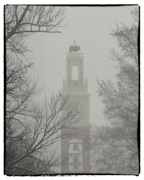 Snow falls on Bell Tower.