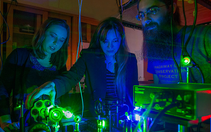 Burcin Bayram and her physics students watch as molecules react to ultrafast laser beams.