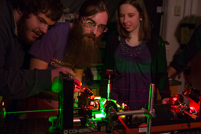 Students study atom and molecule reactions using ultrafast lasers.