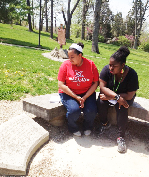 Myka Lipscomb, junior theatre major, left, and Dayday Robinson, graduate student in theatre, reflect at the Freedom Summer Memorial