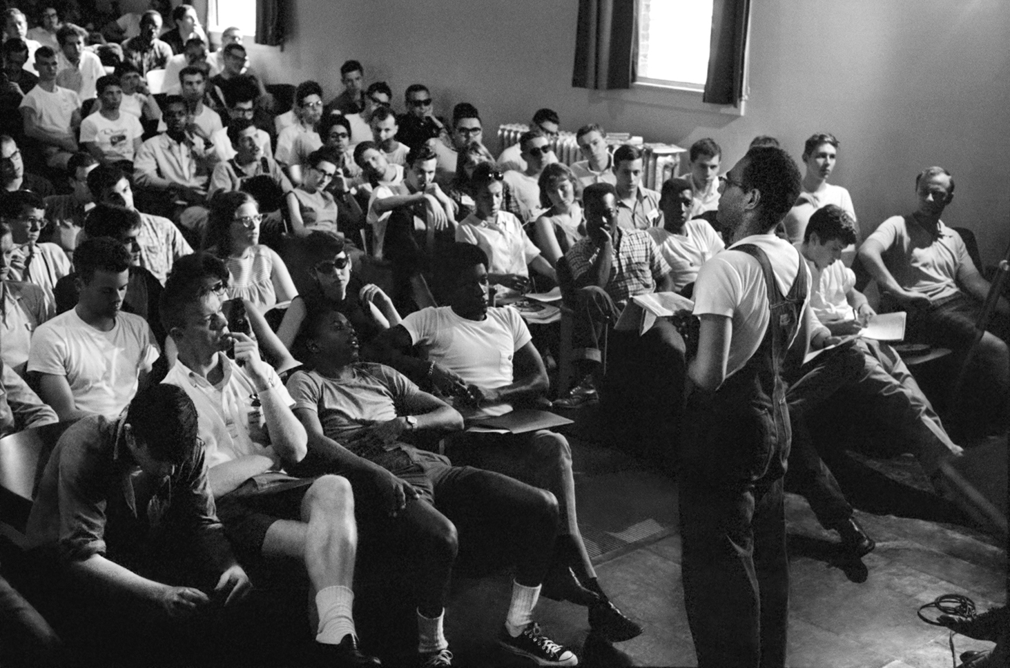 Freedom Summer organizer Bob Moses talks to volunteers at an orientation in Peabody Hall