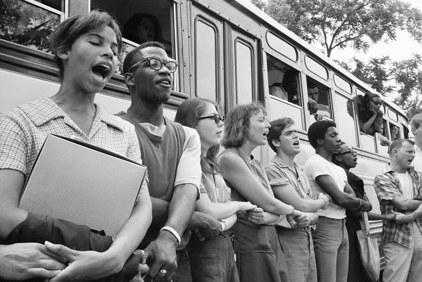 Singing We Shall Overcome, this group of Freedom Summer volunteers begins its journey from Oxford, Ohio to Mississippi. Despite the dangers, more than 1,000 college students volunteered to canvass, teach and establish community centers.