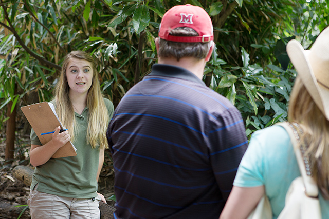 Mary Kate talks with visitors at the zoo