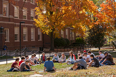 Students enjoy a classroom outside during a sunny day at Miami.