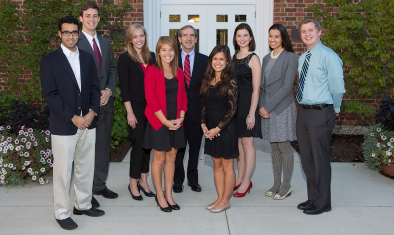 The 2014 Provost's Academic Achievement Award winners, from left to right:  Sam Korach, Daniel Ferriell, Kirsten Melling, Nicole Fisher, Interim Provost Ray Gorman, Asia Ameigh, Carly Mungovan, Anissa Khan and Mathew Giffin (photo by Scott Kissell).