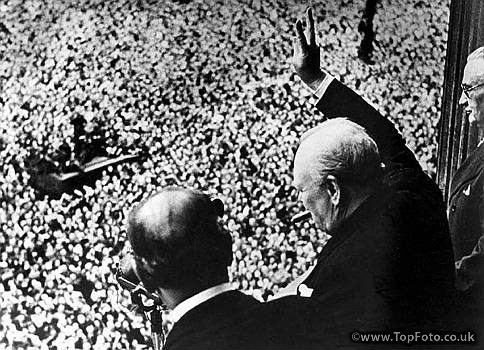 Prime Minister Winston Churchill gives his famous V for Victory sign to a crowd of 50,000 on VE day, May 8, 1945, from the balcony of the Ministry of Health, London. Learn more about Churchill as a leader, writer and artist during Churchill Week.