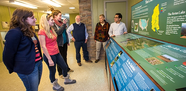 A new exhibit at the Hueston Woods State Park nature center aims to educate visitors about watersheds. Students in a capstone course taught last fall by Mike Vanni, Ann Rypstra and Don Kaufman designed the exhibit. Shown here, left to right: students Ashley Gordon, Rebecca Long and Andrea Christman;  Kaufman, Rypstra and Vanni (photo by Scott Kissell).