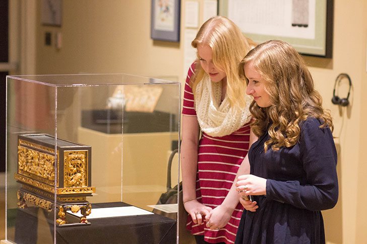 Miami students enjoy new exhibits at the art musuem. (Photo by Scott Kissell).