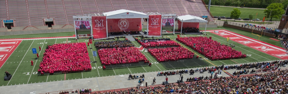 Graduation candidates file into Yager Stadium for the 2014 spring commencement (photo by Scott Kissell).