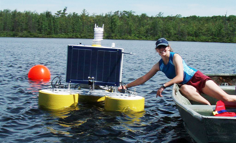 Jennie Brentrup, Miami doctoral student, with a buoy equipped with a suite of sensors to study the seasonal dynamics of dissolved organic carbon in Lake Lacawac. Brentrup is chair of the Global Lake Ecological Observatory Network (GLEON) Student Association.