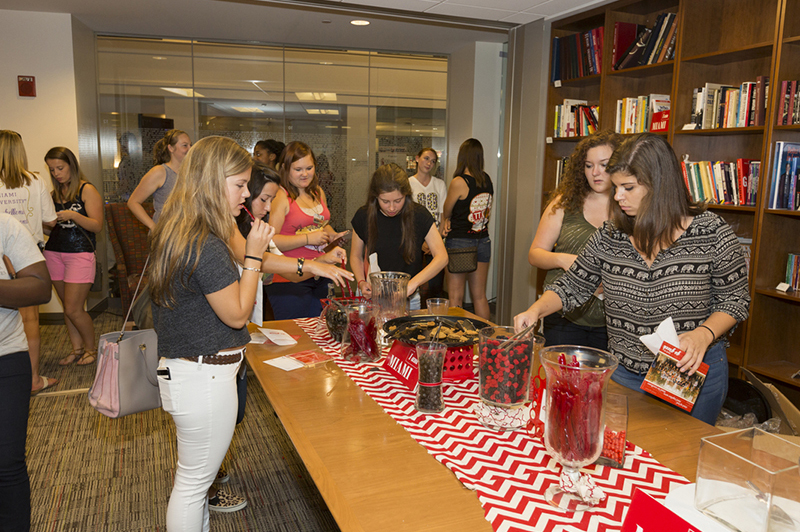 Students fill up bags at a candy bar