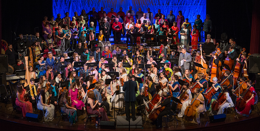 Global Rhythms performances fill the stage with hundreds of musicians and dancers from Miami University and around the world. Photo of the October 2014 concert by Scott Kissell.