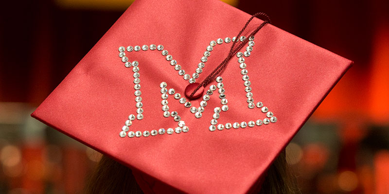 Graduation cap with the Miami M