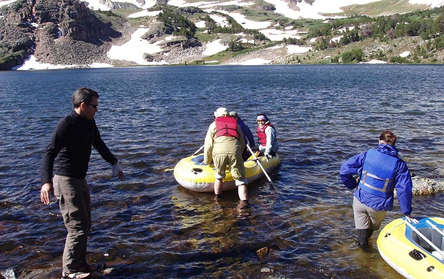 Miami graduate and undergraduate students work with Craig Williamson, professor of biology, to collect samples from a high-elevation lake in Montana's Beartooth Mountains for Williamson's research on the effects of climate change on a series of alpine lakes.