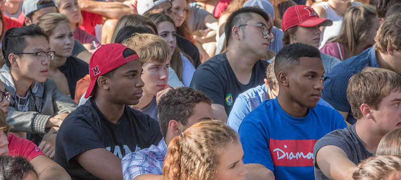 Students of the Class of 2021 were selected from a record number of 30,255 applicants. A group of students listen to a previous year's convocation speaker. Convocation 2017 is Friday, Aug. 25.