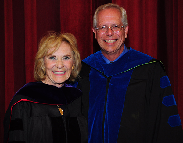 Patricia Breen Lang and Jim Oris, director of the Graduate School celebrate her honorary doctorate degree.