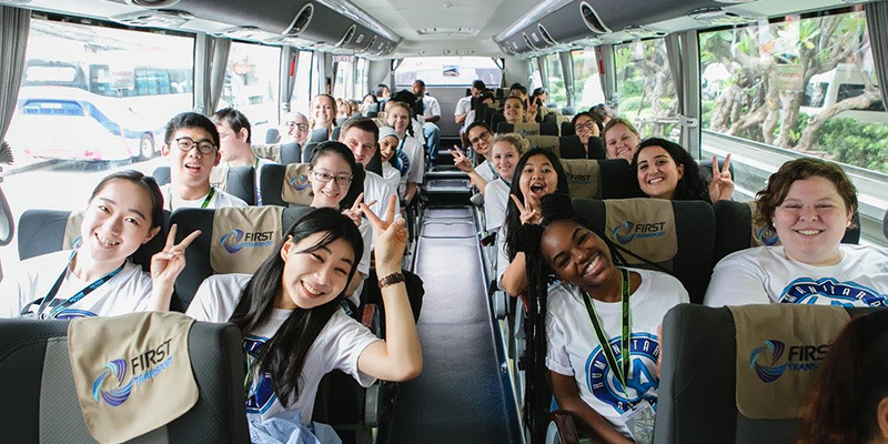 Students touring Bangkok by bus.
