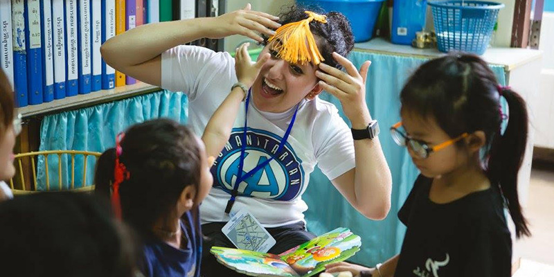 Sara Al-Zubi visits young children at a school while in Bangkok.