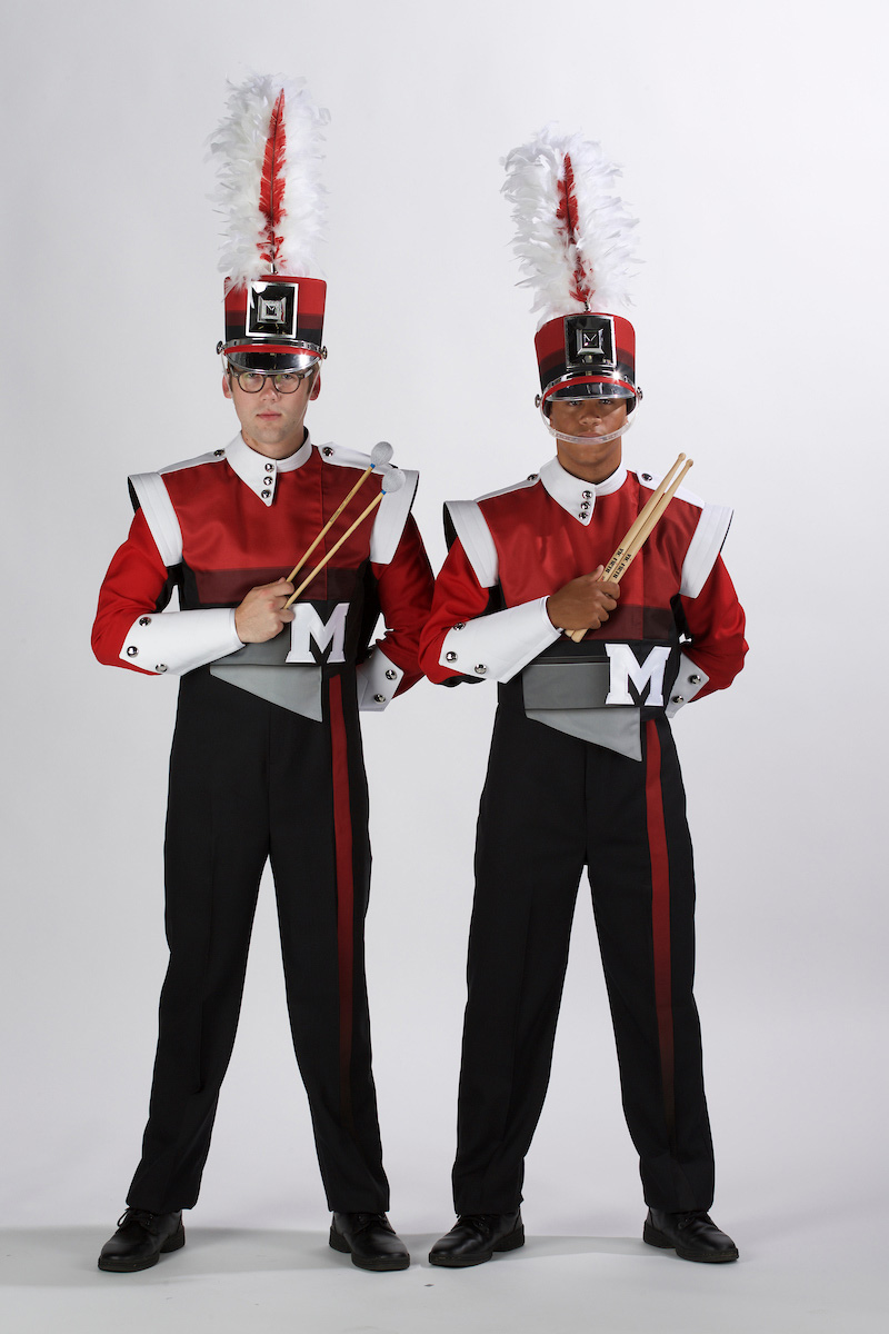 Band members in new uniforms.