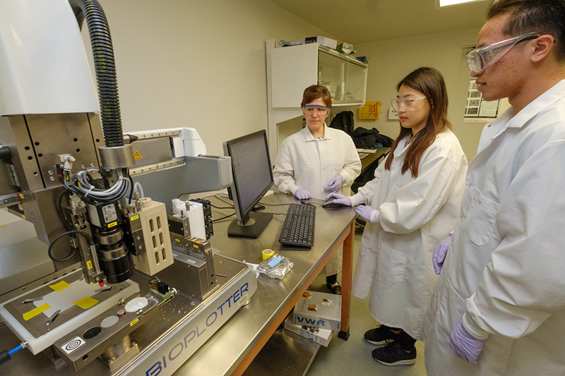 Amy Yousefi discusses bone scaffolding with Songmi Koo, first-year graduate student, and Junyi Liu, a second-year graduate student, both in chemical engineering.