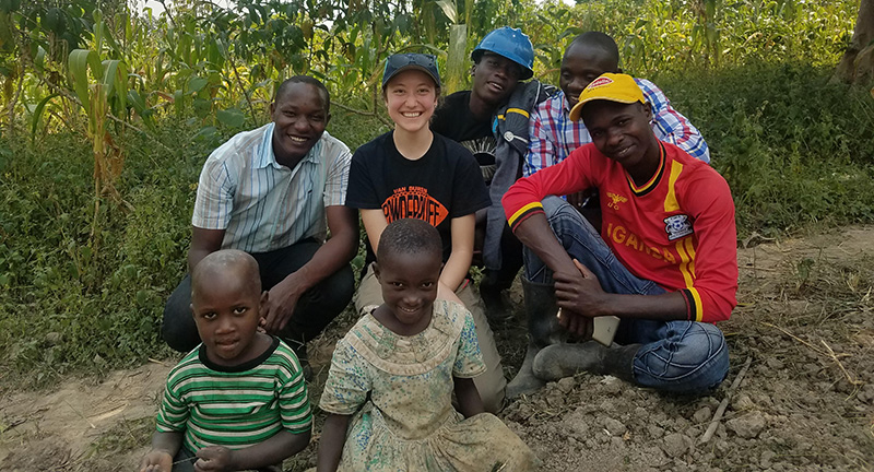 Anne Poindexter enjoys a moment with children for Uganda community.