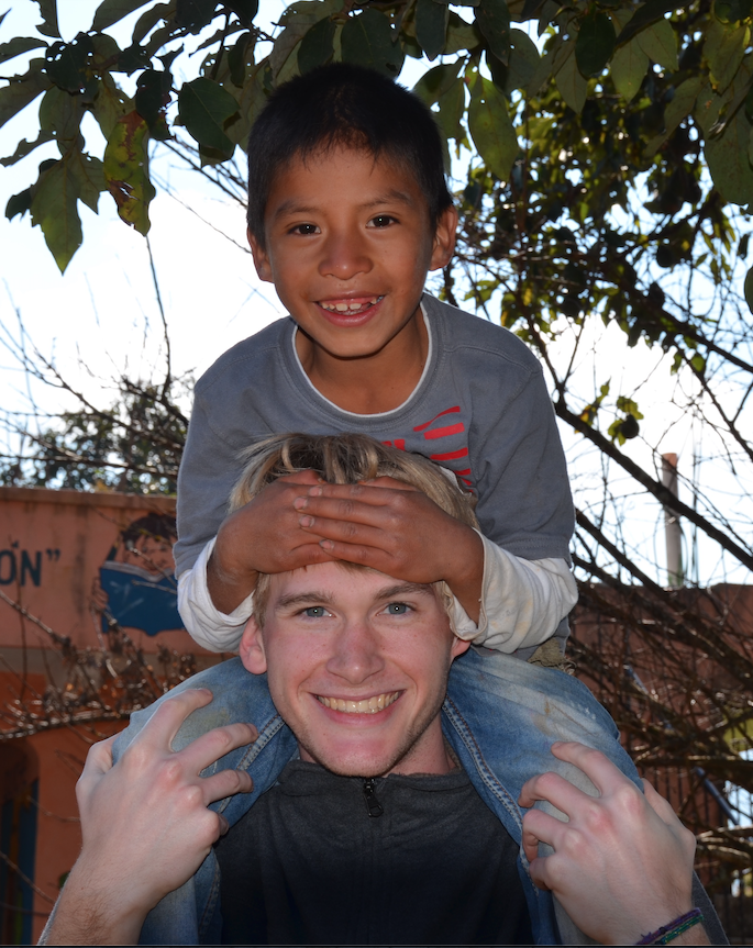 Miami student with boy in Guatemala