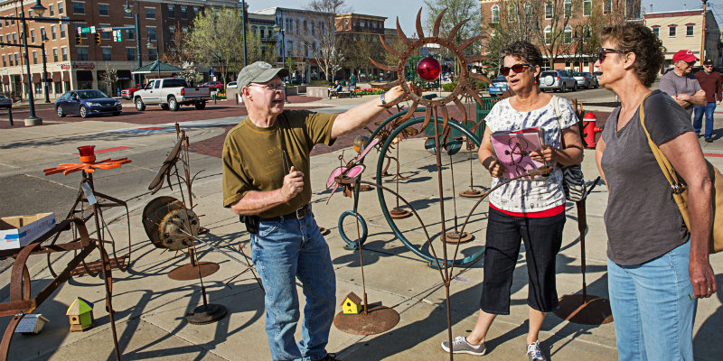 People viewing sculptures for sale in uptown Oxford