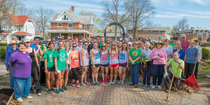 Miami students pose with Oxford residents during Spring Cleanup event