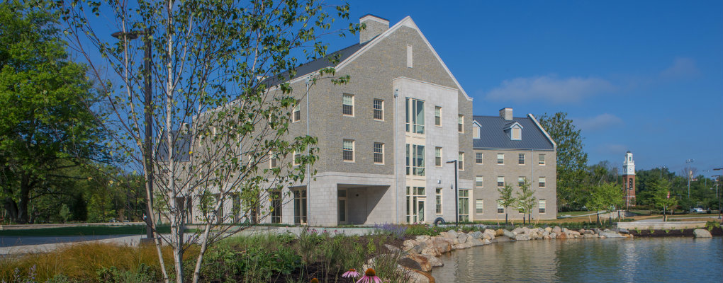 Western Campus Residence Hall next to pond