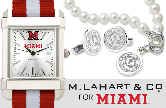 M. LaHart & Co. - with a Miami watch on the left side along with cufflinks and a pearl necklace on the right side