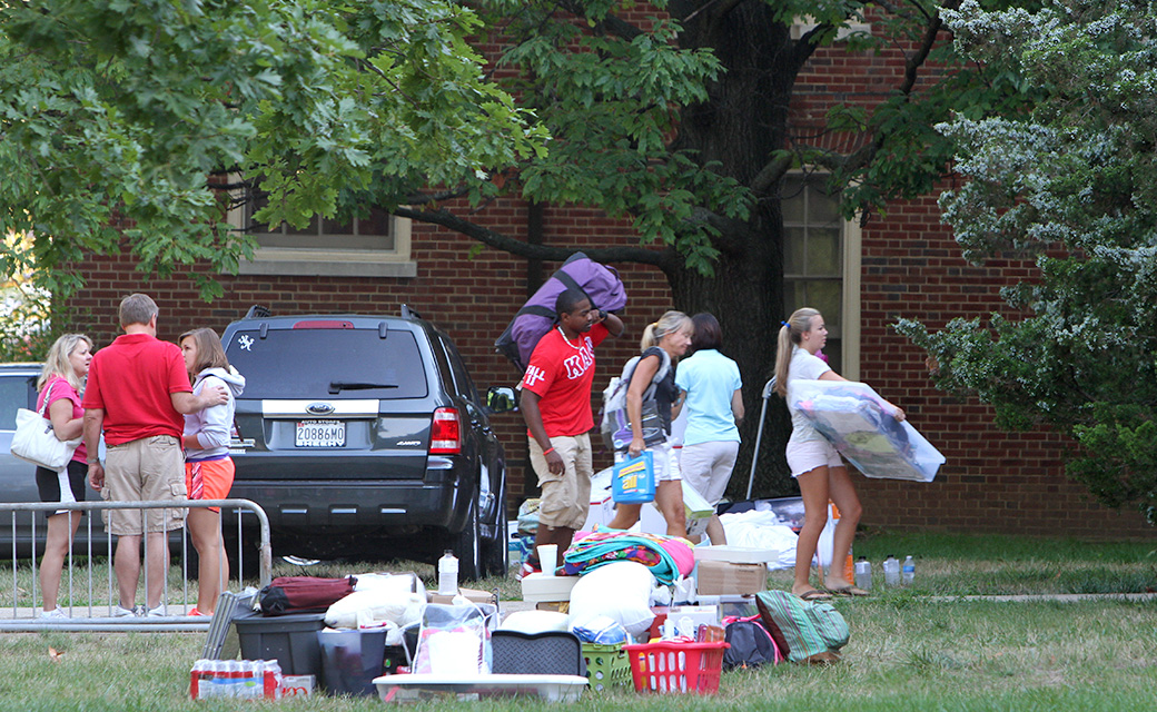 Move-in day is well orchestrated and first year students get help hauling their belongings to their new home away from home.